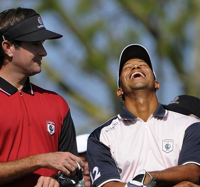 Team Isleworth&#39;s Bubba Watson, left, and Team Albany&#39;s Tiger Woods laugh at the announcer&#39;s joke as they wait to tee off at the first tee during the two-day Tavistock Cup.