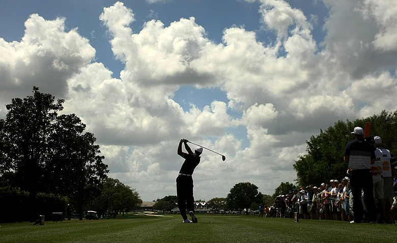 Tiger Woods hits his tee shot at No. 9, his last hole of the day, during the first round. He posted a 69.