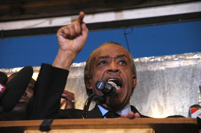 Al Sharpton calls for justice in the killing of Trayvon Martin at a rally in Sanford March 22.
