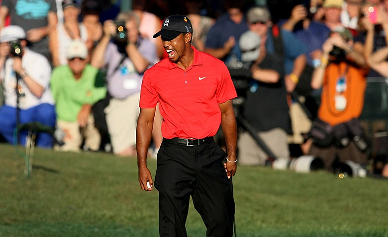 Tiger Woods reacts to his five-shot victory in the 2012 Arnold Palmer Invitational at Bay Hill Club and Lodge.