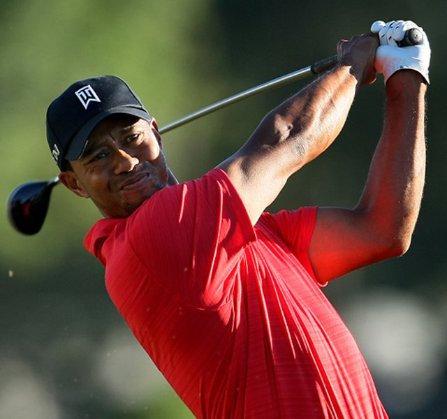 Tiger Woods hits his tee shot at No. 18 during the the final round.