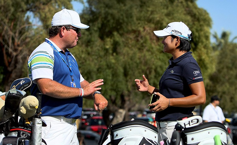2010 Kraft Nabisco champion, Yani Tseng, talks with her instructor Gary Gilchrist on the practice green on Tuesday at the 2012 Kraft Nabisco Championship.