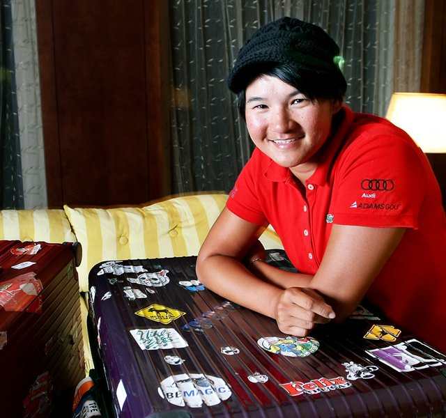Yani Tseng, the Rolex Player of the Year, poses in her hotel room the night before winning the Sunrise LPGA Taiwan Championship.