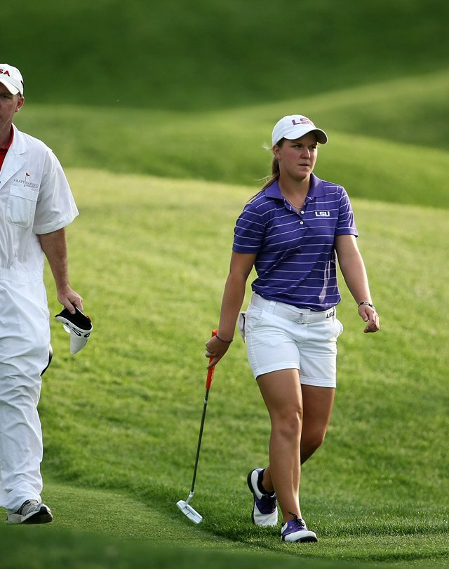 Austin Ernst walks down No. 18 with her father/caddie Mark Ernst on Thursday at the Kraft Nabisco Championship.