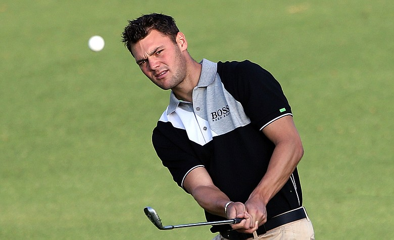 Martin Kaymer of Germany hits an approach shot during a practice round prior to the start of the 2012 Masters Tournament at Augusta National.