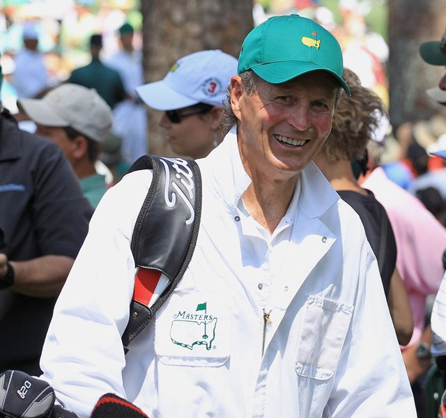Paul Henderson caddied for Mark O'Meara during the Par 3 Contest on Wednesday at Augusta National.
