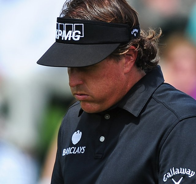 Phil Mickelson prepares to putt on the second hole during the first round of the 76th Masters. Mickelson fired a 2-over 74 in the first round.