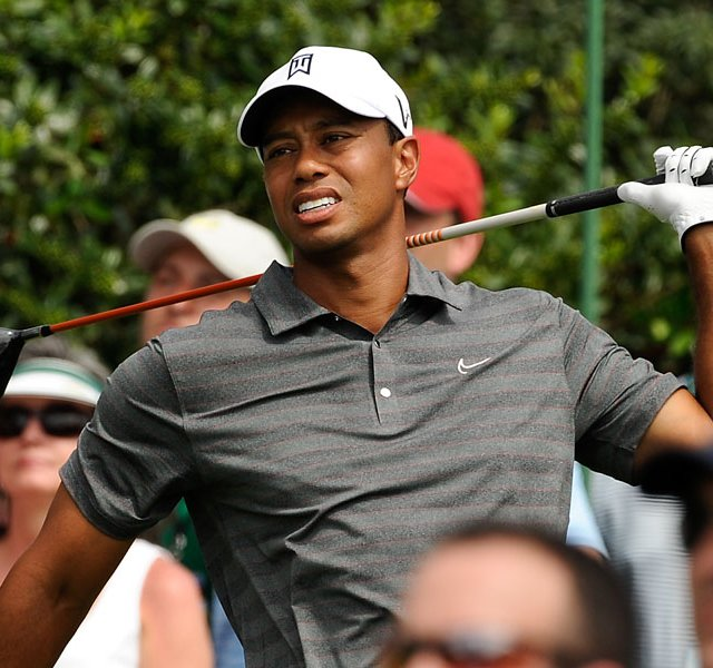Tiger Woods reacts to his tee shot on the 15th hole during the first round of the 76th Masters golf tournament at Augusta National.