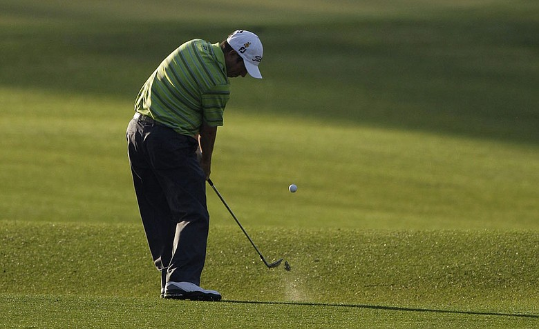 Tim Clark, of South Africa, hits his approach shot to the second green during the first round of the Masters.