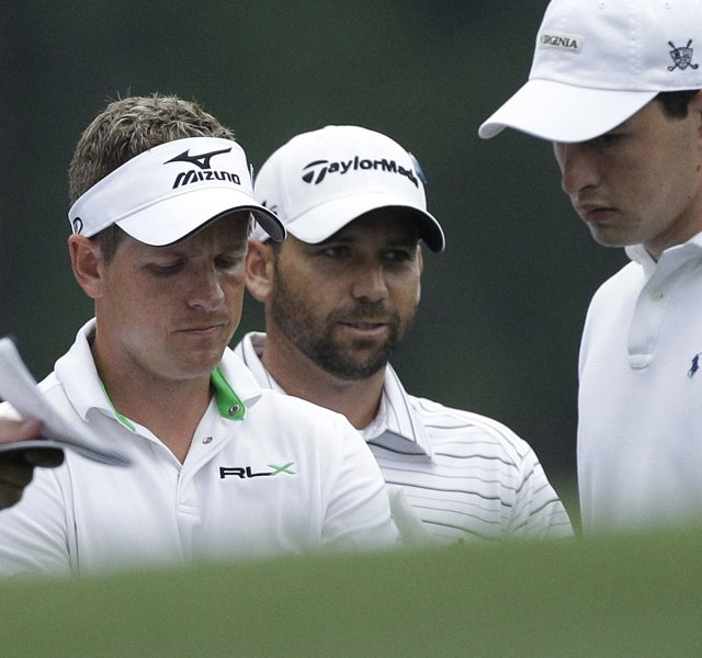 Luke Donald, left, stands with Sergio Garcia and Patrick Cantlay at the 11th hole of Augusta National.