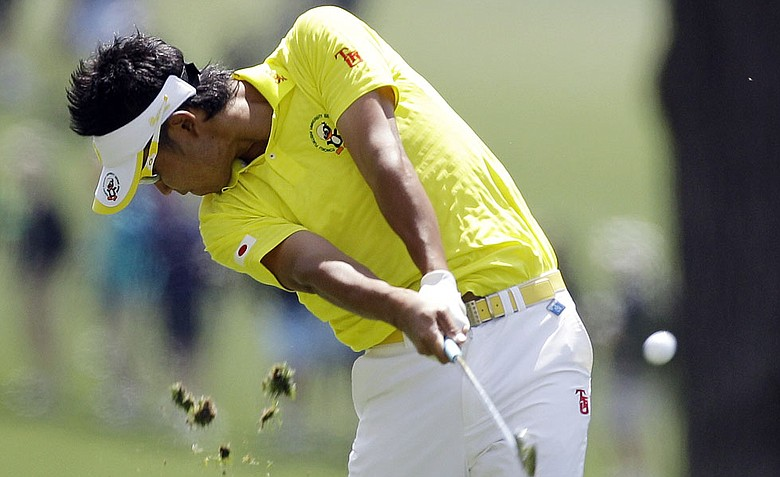 Amateur Hideki Matsuyama, of Japan, hits off the first fairway during the second round the Masters.
