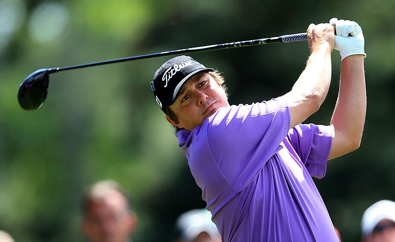 Jason Dufner hits a tee shot on the 18 hole during the second round of the 2012 Masters Tournament at Augusta National.