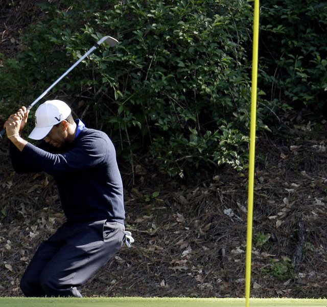 Tiger Woods reacts to missing a birdie chip on the 12th green during the second round of the Masters.