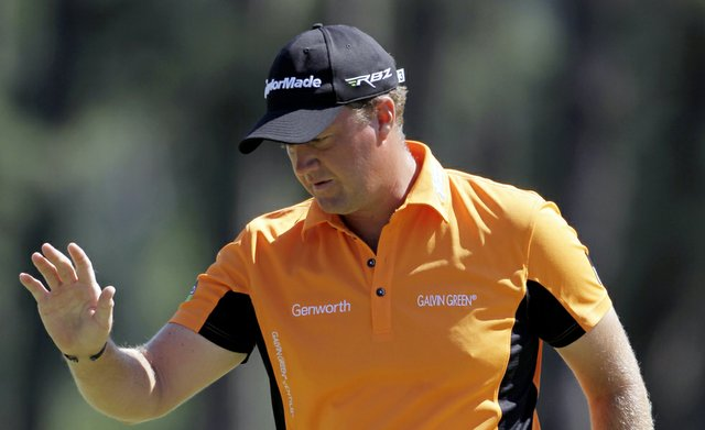 Peter Hanson, of Sweden, waves after his birdie on the eighth green during the third round of the Masters.