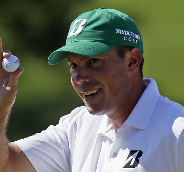 Matt Kuchar holds up his ball after a birdie putt on the seventh green during the third round of the Masters.