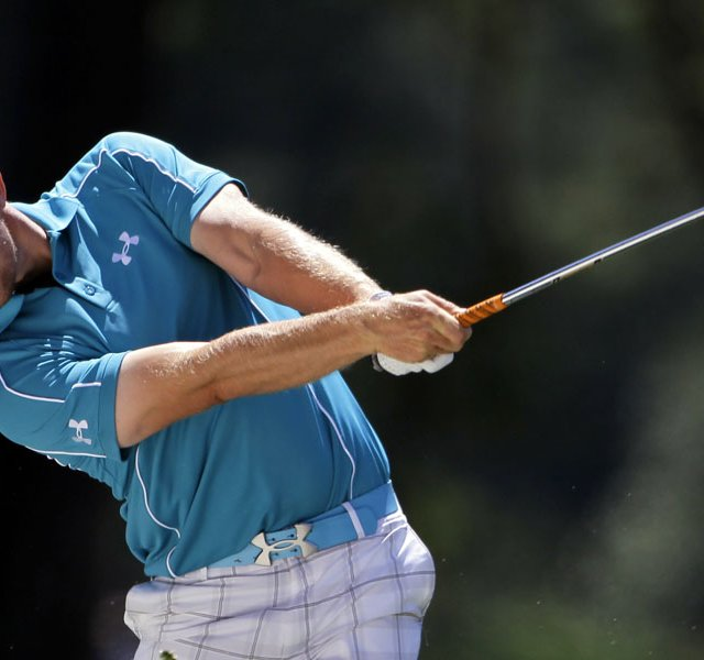 Hunter Mahan hits off the first fairway during the third round of the Masters.
