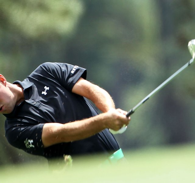 Gary Woodland of the United States hits an approach shot on the first hole during the second round of the 2012 Masters Tournament at Augusta National.