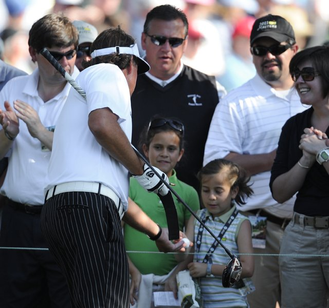 Phil Mickelson gives a girl a a ball on the 15th hole during the third round. The 15th hole is the sight of Mickelson's improbable lob shot from off the green that resulted in an improbable birdie.