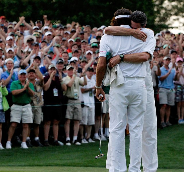 Bubba Watson hugs his caddie Ted Scott after winning his sudden-death playoff on the second playoff hole to win the 2012 Masters.