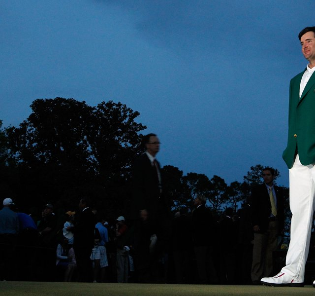 Bubba Watson dons the green jacket after winning the 2012 Masters in a two-hole, sudden-death playoff with Louis Oosthuizen.