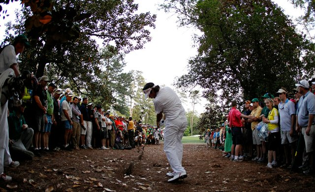Bubba Watson hits a gap wedge from just over 160 yards out of the straw during the second hole of a sudden-death playoff. Watson would land the improbable shot on the green and he two-putted to win the Masters.
