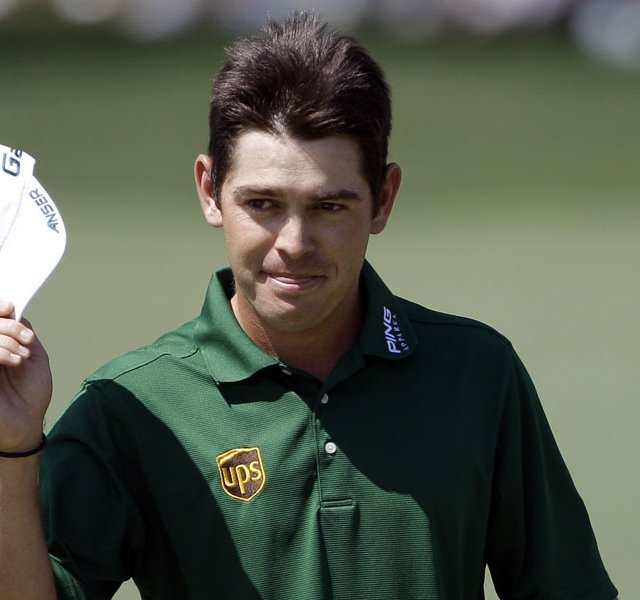 Louis Oosthuizen, of South Africa, tips his cap after hitting a double eagle two on the par 5 second hole during the fourth round of the Masters.