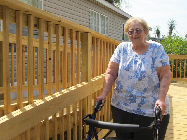 The team of RLF and Allan & Conrad donated more than $3,000 and provided design and volunteer services to help build a handicap ramp for a 77-year-old resident.