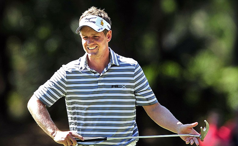 Luke Donald, of England, reacts after making a par putt on the 12th green during the second round of the RBC Heritage.