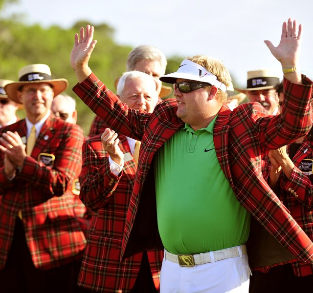 Carl Pettersson waves to the crowd after putting on the tartan jacket on 18th fairway during the 2012 RBC Heritage.