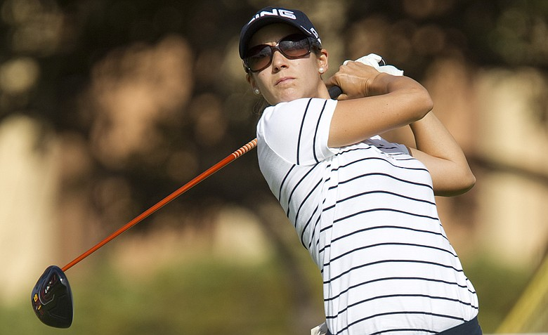 Azahara Munoz watches her drive off the first tee during the second round of the LPGA Lotte Championship.