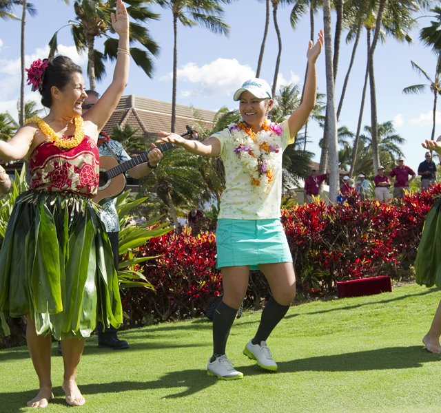Ai Miyazato, center, dances the hula after winning the LPGA LOTTE Championship golf tournament at Ko Olina Golf Club.