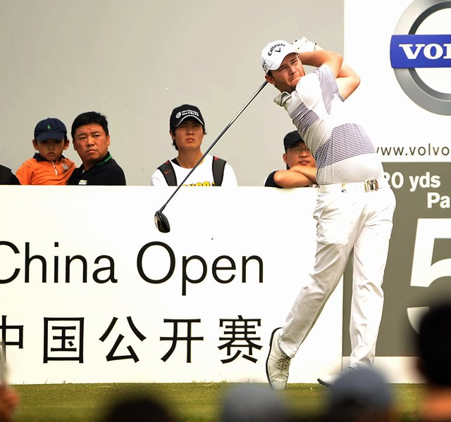 Branden Grace of South Africa tees off on his way to winning the China Open golf tournament at the Binhai Lake Golf Club in Tianjin, China.