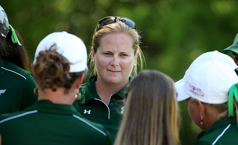 University of South Florida's head coach Marci Kornegay talks with her team after they won the Big East Women's Championship at Reunion Resort.