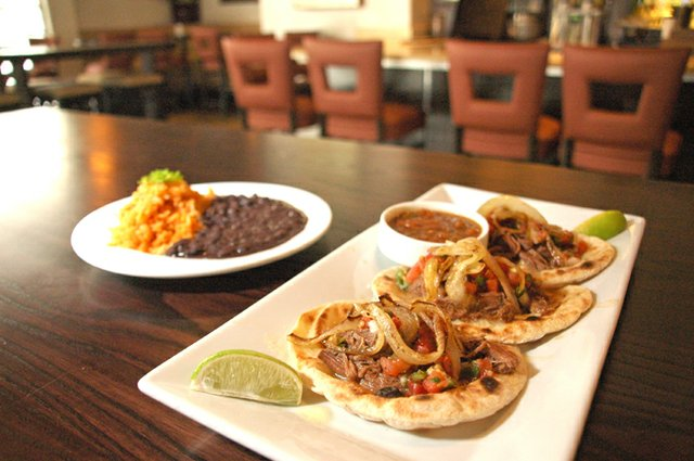Observer food critic Josh Garrick raved about the beef brisket tacos at Cocina 214.