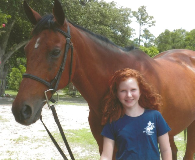 Delaney with her horse, Dallas.