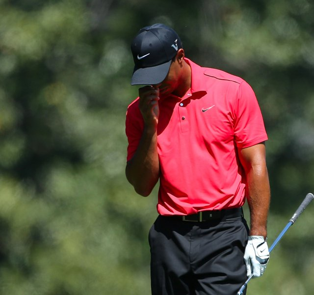 Tiger Woods of the United States reacts after an approach shot on the fifth hole during the final round of the 2012 Masters Tournament at Augusta National.