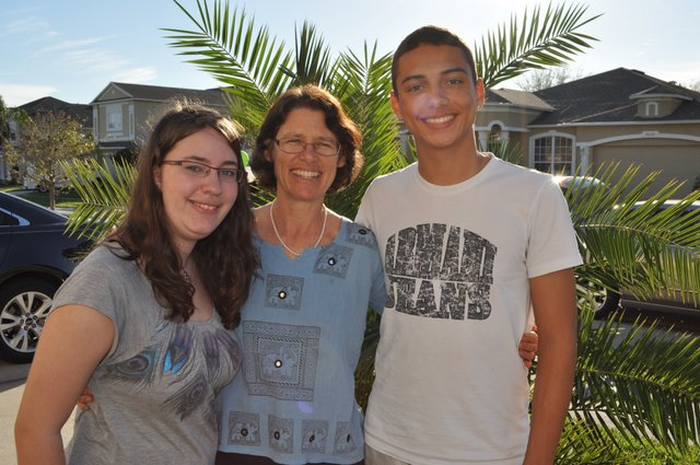 Swiss exchange students Pascal Zurcher and Sarah Stebler pose with Betsy Huth, a former exchange student and volunteer with AFS Intercultural Programs.