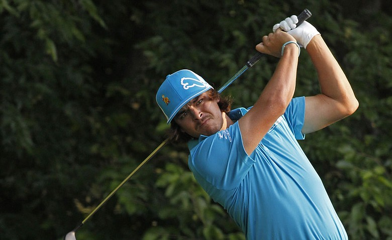 Rickie Fowler watches his tee shot on the fifth hole during the first round of the Wells Fargo Championship.
