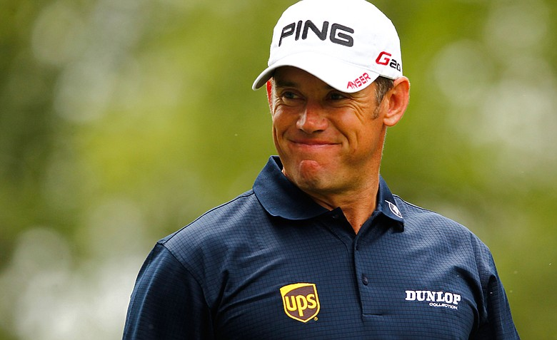 Lee Westwood smiles after hitting his tee shot on the fourth hole during the final round of the Wells Fargo Championship at the Quail Hollow Club.