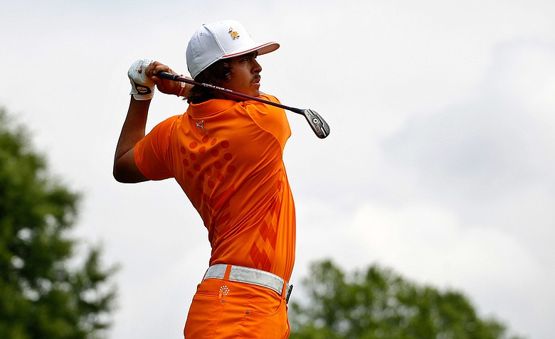 Rickie Fowler hits his tee shot on the first hole during the final round of the Wells Fargo Championship at the Quail Hollow Club.