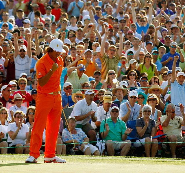 Rickie Fowler celebrates after making a putt for birdie on the first playoff hole to defeat Rory McIlroy and D.A. Points during the final round to win the Wells Fargo Championship at the Quail Hollow Club.