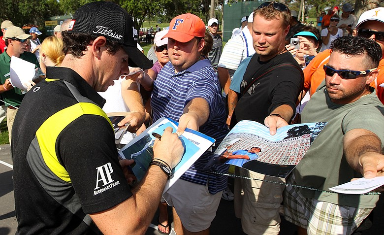Rory McIlroy signs his autograph for fans during a practice round prior to the start of THE PLAYERS Championship.