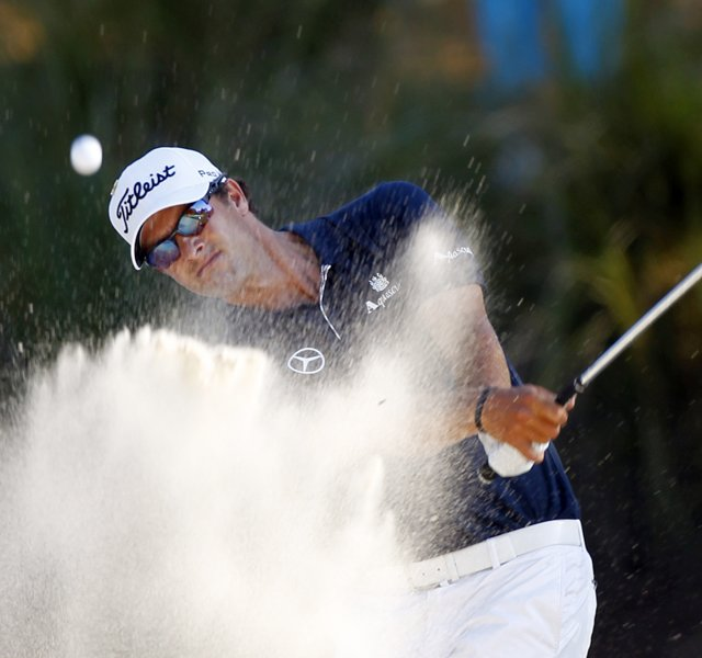 Adam Scott, of Australia, hits from the sand on the 16th hole during the first round of the Players Championship.
