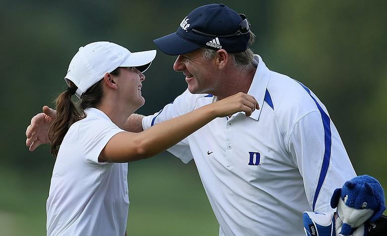 Duke head coach Dan Brooks hugs junior Lindy Duncan.