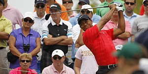Woods (73) finishes unremarkable Players