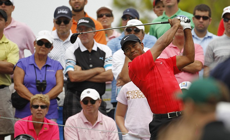 Tiger Woods hits from the fourth tee during the final round of the Players Championship at TPC Sawgrass, Sunday, May 13, 2012, in Ponte Vedra Beach, Fla.