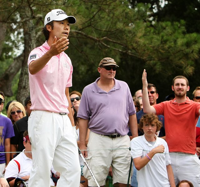 Kevin Na is distracted at No. 9 while trying to hit his tee shot during the final round at The Players Championship at TPC Sawgrass.
