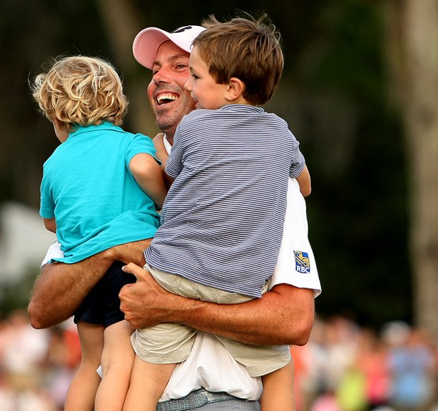 Matt Kuchar with his son, Cameron, 4, right and Carson, 2, left, after winning The Players Championship at TPC Sawgrass.