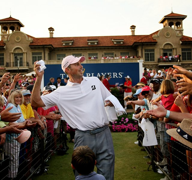 Matt Kuchar tosses signed flags after he won The Players Championship at TPC Sawgrass.