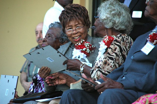 Honoree Bessie Davenport, left, talks with Katrene Bentley at the unveiling of the Sage Project in Winter Park May 11.